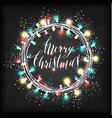christmas lights on a wooden background vector image