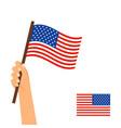 human hand holding flag of usa vector image