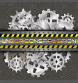 Under construction with gears and pinions vector image