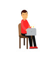 young man sitting on a chair working with laptop vector image