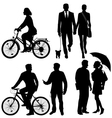 Several people on the street - silhouettes vector image