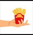 hand holding french fries vector image