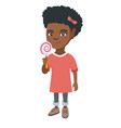 little african girl holding a lollipop candy vector image