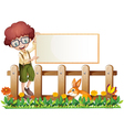 A boy at the fence holding an empty board vector image vector image