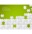 green background made from white puzzle pieces vector image vector image
