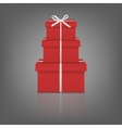 Stack of three realistic red gift boxes with white vector image