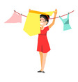 cheerful woman drying clothes vector image