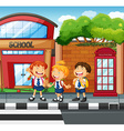 Three students waiting to cross the road vector image
