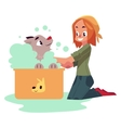 Red haired teenage girl washing bathing her dog vector image