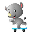 Cute rhino playing skateboard vector image