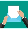 hand pulls from envelope a sheet of empty paper vector image