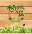 world environment day on grass against a wooden ba vector image