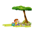 A boy and his cat under the tree vector image vector image