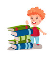 cute redhead boy standing next to a pile of books vector image