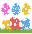 set of colored isolated easter eggs on green vector image