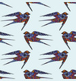 swallow hand drawing seamless pattern on a blue vector image