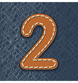 Number 2 made from leather on jeans background vector image