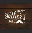 happy fathers day handwritten lettering on dark vector image