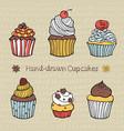 set of hand-drawn cupcakes vector image