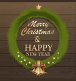 christmas fir wreath on wooden background vector image