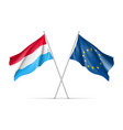 Luxembourg and european union waving flags vector image
