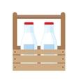 Milk bottles in wooden box vector image