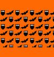 seamless halloween pattern on orange background vector image