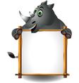funny rhino cartoon with blank sign vector image