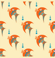 orange fish with blue ornament on a beige vector image