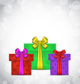 Set Christmas gift boxes on light background vector image