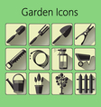 Black gardening icons set over a green background vector image
