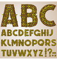 golden swirly alphabet vector image