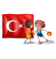 Two boys playing basketball in front of the flag vector image