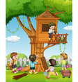 Children playing at the treehouse in the garden vector image