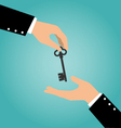 Business hand giving a house key to another hand vector image