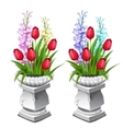 Red tulips and other flowers in stone vase vector image
