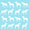 unicorn silhouettes over blue background vector image