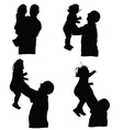 man throws baby into the air silhouette vector image