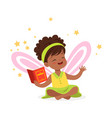 sweet african little girl with a book dreaming vector image