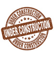 under construction brown grunge round vintage vector image