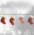 Hanging christmas socks on a clothesline vector image vector image