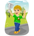 boy celebrating his victory waving his trophy vector image